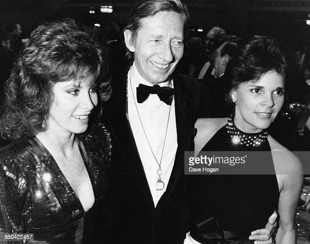 Actors Stephanie Powers Jeremy Lloyd and Ali McGraw at the BAFTA Awards in London March 18th 1986
