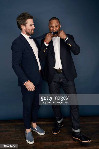 Actors Stephen Amell and David Ramsey of The CW's 'Arrow' pose for a portrait during the 2019 Summer TCA Portrait Studio at The Beverly Hilton Hotel...