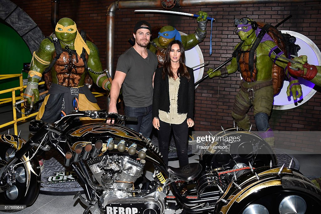 "Actors Stephen Amell (L) and Megan Fox attend an autograph signing at WonderCon 2016 to promote the upcoming release of Paramount Pictures' ""Teenage Mutant Ninja Turtles – Out of The Shadows"", on March 25, 2016 at the LA Convention Center in Los Angeles, California."