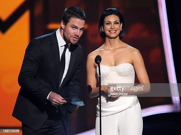 Actors Stephen Amell and Morena Baccarin speak onstage at the 39th Annual People's Choice Awards at Nokia Theatre LA Live on January 9 2013 in Los...