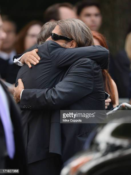 Actors Steve Buscemi and Michael Imperioli embrace at the funeral for actor James Gandolfini at The Cathedral Church of St John the Divine on June 27...