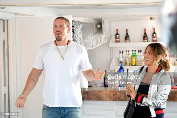 Actors Steve Howey and Sarah Shahi attend Steve Howey's Surprise 40th Birthday Party on July 16 2017 in Los Angeles California