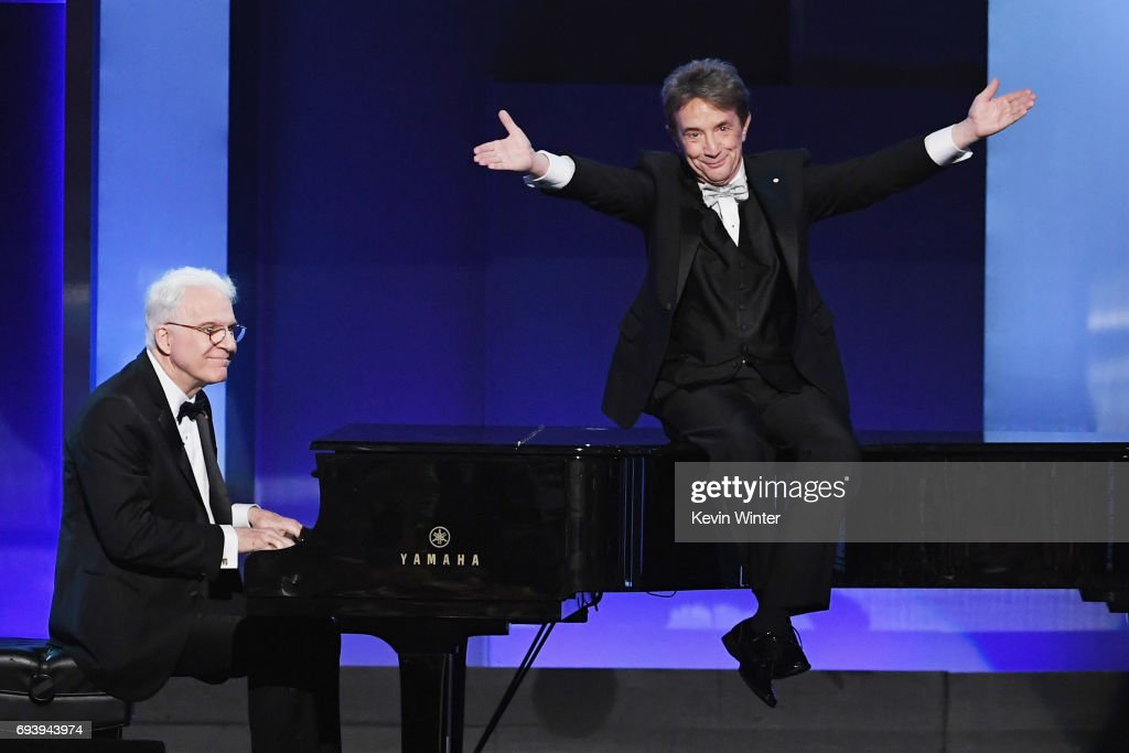 Actors Steve Martin (L) and Martin Short perform onstage during American Film Institute's 45th Life Achievement Award Gala Tribute to Diane Keaton at Dolby Theatre on June 8, 2017 in Hollywood, California. 26658_007
