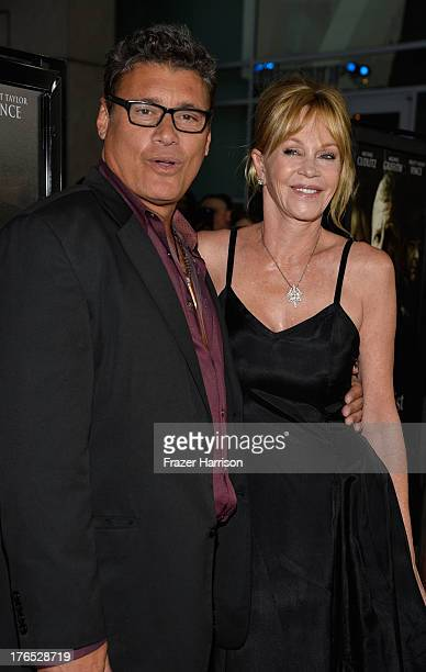 Actors Steven Bauer and Melanie Griffith arrive at the Premiere Of Dark Tourist at ArcLight Hollywood on August 14 2013 in Hollywood California