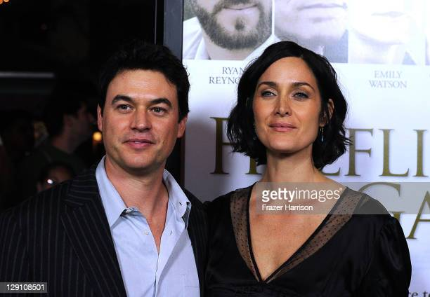 Actors Steven Roy and CarrieAnne Moss arrive at the pemiere of Fireflies In The Garden at the Pacific Theaters at the Grove on October 12 2011 in Los...