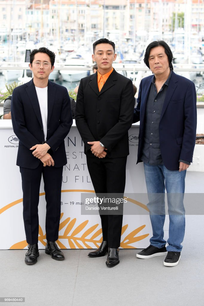 Actors Steven Yeun, Ah-in Yoo and director Lee Chang-dong attend the photocall for the 'Burning' during the 71st annual Cannes Film Festival at Palais des Festivals on May 17, 2018 in Cannes, France.