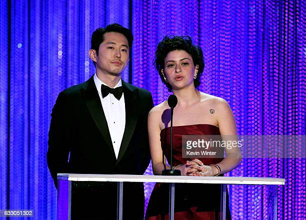 Actors Steven Yeun and Alia Shawkat speak onstage during The 23rd Annual Screen Actors Guild Awards at The Shrine Auditorium on January 29 2017 in...