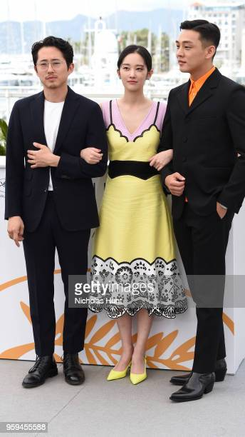 Actors Steven Yeun Jongseo Jeon and Ahin Yoo attend 'Burning' Photocall during the 71st annual Cannes Film Festival at Palais des Festivals on May 17...