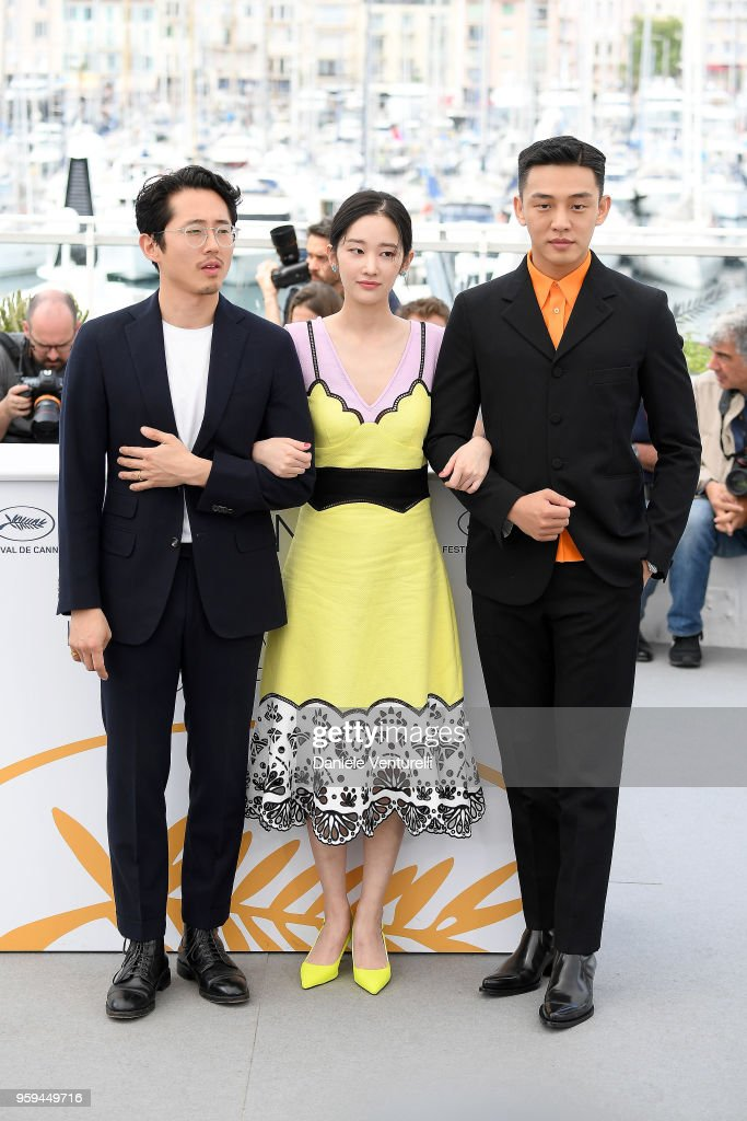 Actors Steven Yeun, Jong-seo Jeon and Ah-in Yoo attend the photocall for the 'Burning' during the 71st annual Cannes Film Festival at Palais des Festivals on May 17, 2018 in Cannes, France.