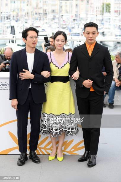 Actors Steven Yeun Jongseo Jeon and Ahin Yoo attend the photocall for the 'Burning' during the 71st annual Cannes Film Festival at Palais des...