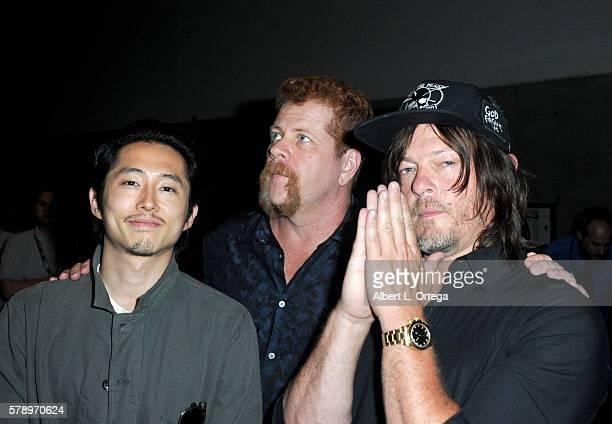 Actors Steven Yeun Michael Cudlitz and Norman Reedus attend AMC's 'The Walking Dead' panel during ComicCon International 2016 at San Diego Convention...