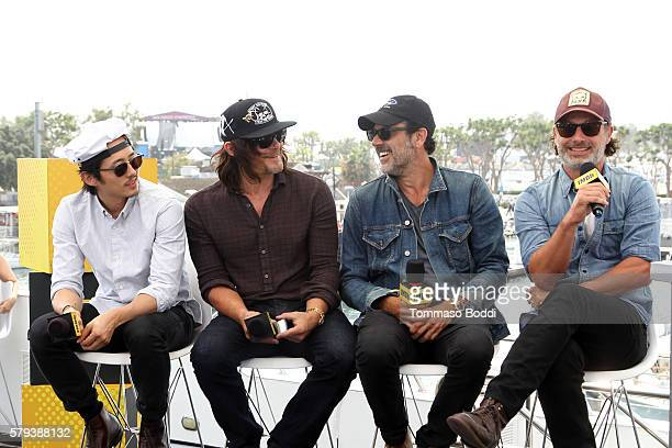 Actors Steven Yeun Norman Reedus Jeffrey Dean Morgan and Andrew Lincoln of The Walking Dead attend the IMDb Yacht at San Diego ComicCon 2016 Day...