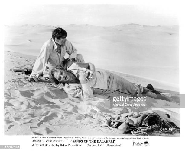 Actors Stuart Whitman and Stanley Baker on set of Paramount Pictures movie Sands of the Kalahari in 1965