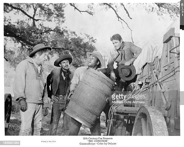 Actors Stuart Whitman Anthony Franciosa and Jim Brown on set of the 20th Century Fox movie Rio Conchos in 1964
