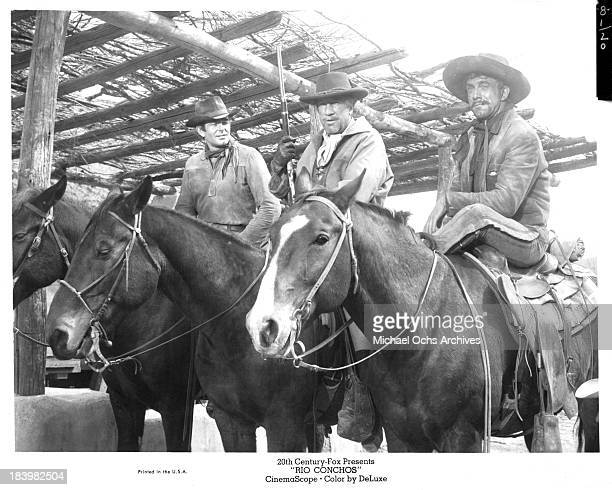 Actors Stuart Whitman Richard Boone and Anthony Franciosa on set of the 20th Century Fox movie Rio Conchos in 1964