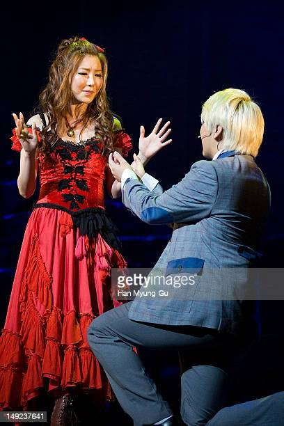 Actors Sungmin of South Korean boy band Super Junior and JMin perform onstage during the press call performance of 'Jack The Ripper' at The National...