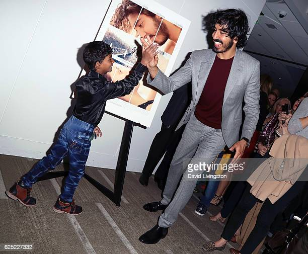 Actors Sunny Pawar and Dev Patel attend a Los Angeles special screening of The Weinstein Co's 'Lion' at the Samuel Goldwyn Theater on November 22...