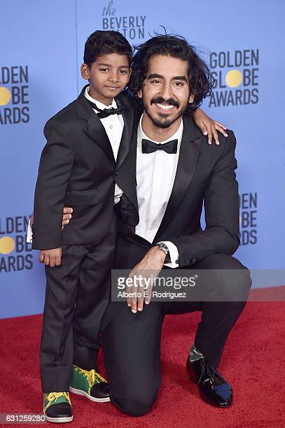 Actors Sunny Pawar and Dev Patel poses in the press room during the 74th Annual Golden Globe Awards at The Beverly Hilton Hotel on January 8 2017 in...