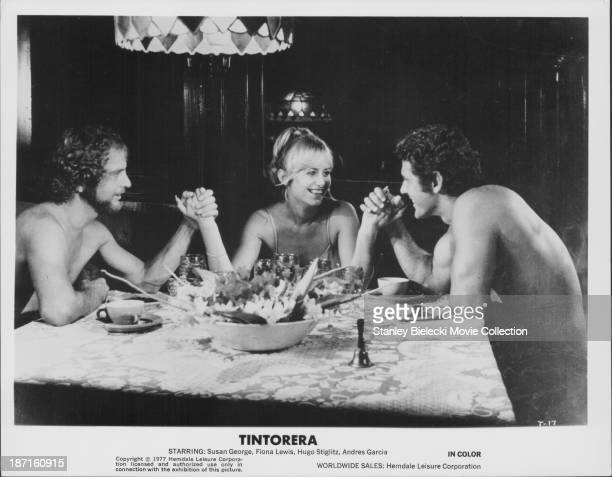 Actors Susan George Hugo Stiglitz and Andres Garcia in a scene from the movie 'Tintorera' 1977
