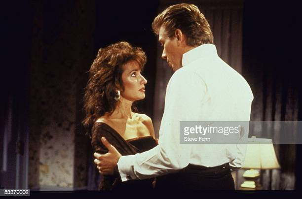 Actors Susan Lucci Walt Willey chatting while standing in scene from TV series 'All My Children'