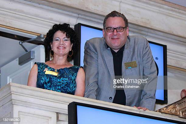 Actors Susie Essman and Jeff Garlin ring the opening bell at the New York Stock Exchange on July 6, 2011 in New York City.
