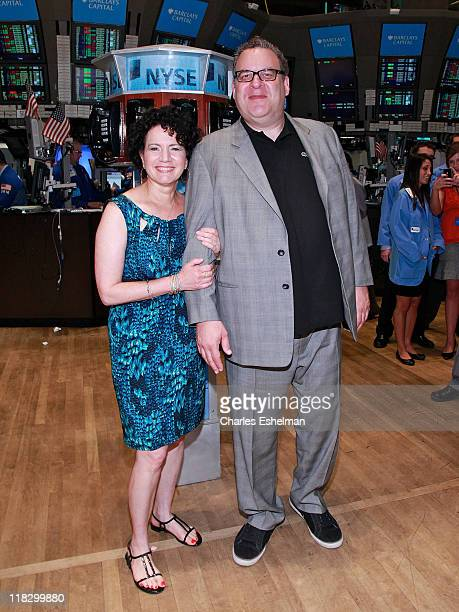 Actors Susie Essman and Jeff Garlin tour the trading floor at the New York Stock Exchange on July 6, 2011 in New York City.