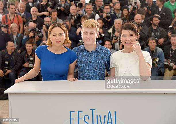 Actors Suzanne Clement Olivier Pilon and Anne Dorval attend the 'Mommy' photocall during the 67th Annual Cannes Film Festival on May 22 2014 in...