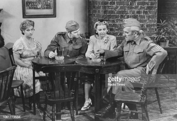Actors Suzanne Kerchiss Ian Lavender Janet Davies and John Le Mesurier in a scene from episode 'My British Buddy' of the television sitcom 'Dad's...