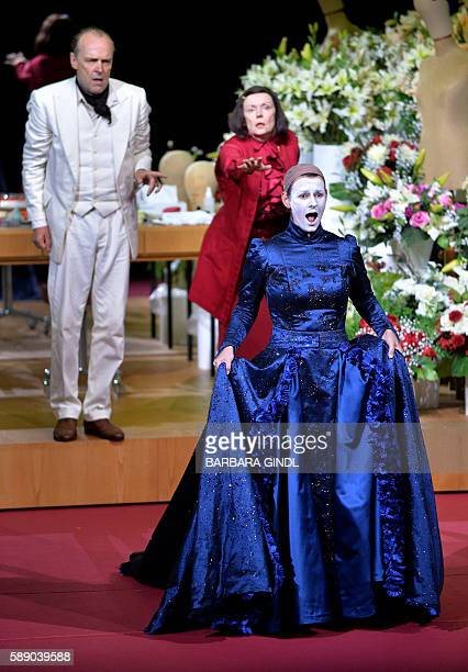 Actors SvenEric Bechtolf as 'Doctor' Annett Renneberg as 'Queen of the Night' and Barbara de Koy as 'Frau Vargo' perform during the rehearsal of the...