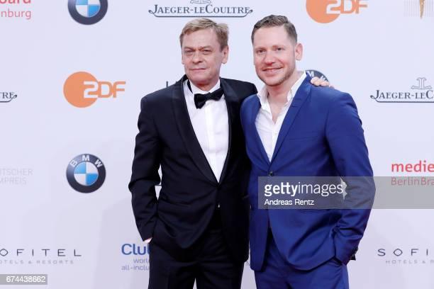 Actors Sylvester Groth and Marco Kreuzpaintner attend the Lola German Film Award red carpet at Messe Berlin on April 28 2017 in Berlin Germany