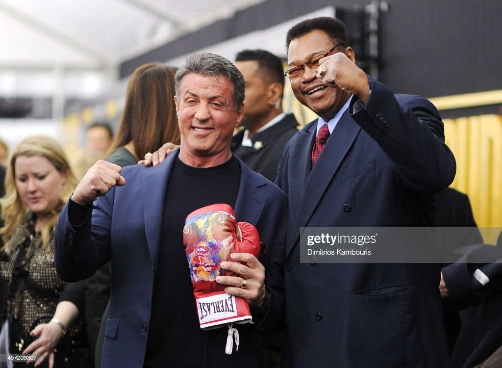 Actors Sylvester Stallone and former professional boxer Larry Holmes attend the 'Grudge Match' screening benefiting the Tribeca Film Insititute at Ziegfeld Theater on December 16, 2013 in New York City.
