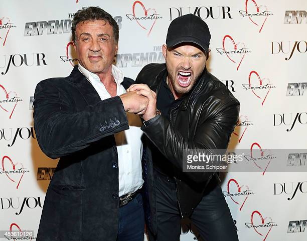 Actors Sylvester Stallone and Kellan Lutz attend the DuJour Summer Cover Celebration With Sylvester Stallone at Provocateur on August 14 2014 in New...