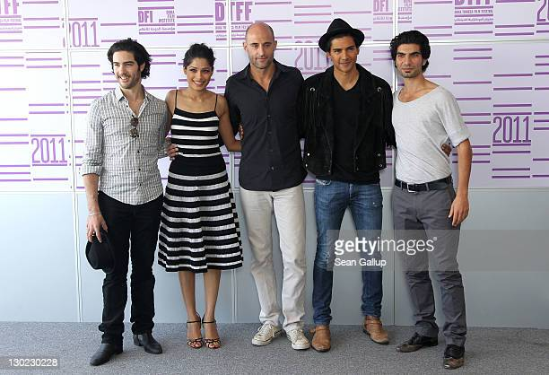 Actors Tahar Rahim Freida Pinto Mark Strong Jan Uddin and Akin Gazi attend the Black Gold photocall at the Press Centre during day 1 of the 2011 Doha...