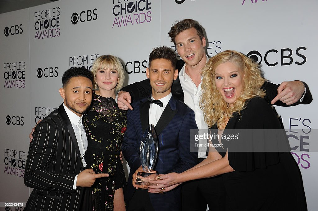 Actors Tahj Mowry, Chelsea Kane, Jean-Luc Bilodeau, Derek Theler and Melissa Peterman, winner of the Favorite Cable TV Comedy Award, 'Baby Daddy', pose in the press room at the People's Choice Awards 2017 at Microsoft Theater on January 18, 2017 in Los Angeles, California.