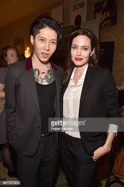 Actors Takamasa Ishihara and Angelina Jolie attend the 15th Annual AFI Awards at Four Seasons Hotel Los Angeles at Beverly Hills on January 9 2015 in...