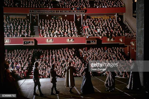 Actors take a curtain call for the audience after a performance at the Royal Shakespeare Theatre in William Shakespeare's birthplace of...