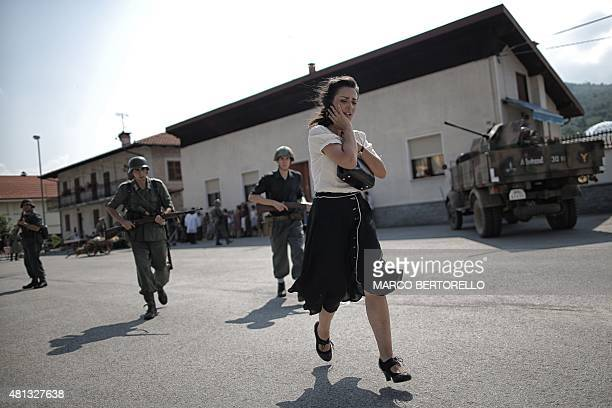 Actors take part in a battle reenactment of the raid of Rossana a small village near Cuneo on July 19 2015 This year marks the 71th anniversary of...