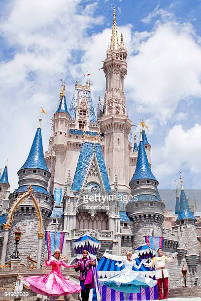 Actors take part in a performance in front of Cinderalla Castle at Magic Kingdom part of the Walt Disney World theme park and resort in Lake Buena...