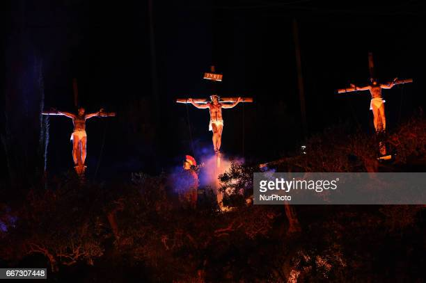 Actors take part in a reenactment of the crucifixion of Jesus by the Romans on Good Friday on April 11 2017 in Meta di Sorrento Italy Christians all...