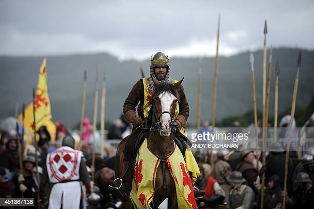 Actors take part in a reenactment to commemorate the 700th anniversary of the Battle Of Bannockburn as part of the Bannockburn Live event in...