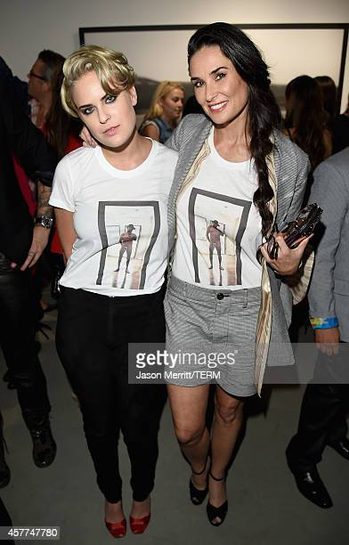 Actors Tallulah Willis and Demi Moore attend the Brian Bowen Smith WILDLIFE show hosted by Casamigos Tequila at De Re Gallery on October 23 2014 in...