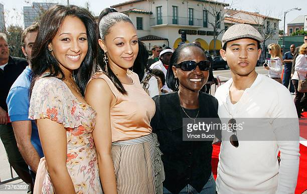 Actors Tamara Tia and Tahj Mowry pose with their mother Darlene Mowry at the Sony Pictures premiere of the film Are We Done Yet at The Mann Village...