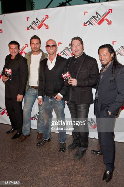 Actors Tamer Hassan Ed Quinn Luke Goss director Jason Hewitt and actor Sam Medina arrive at the 'Blood Out' world premiere at Directors Guild Of...