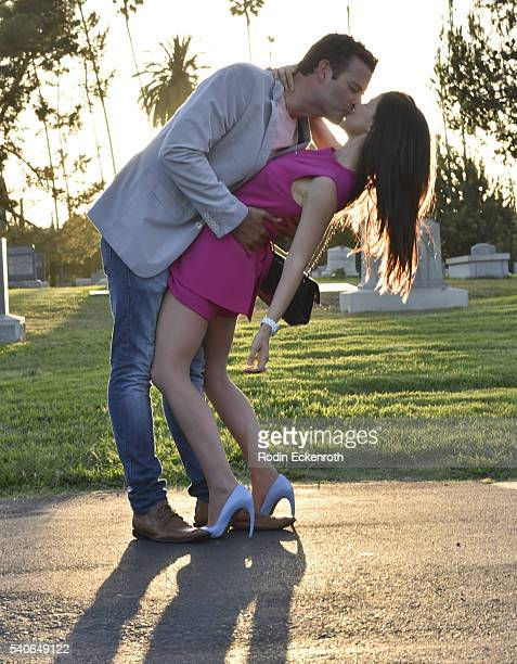 Actors Tammin Sursok and husband Sean McEwen share a kiss at the Premiere of ABC Family's 'Pretty Little Liars' Season 7 at Hollywood Forever on June...