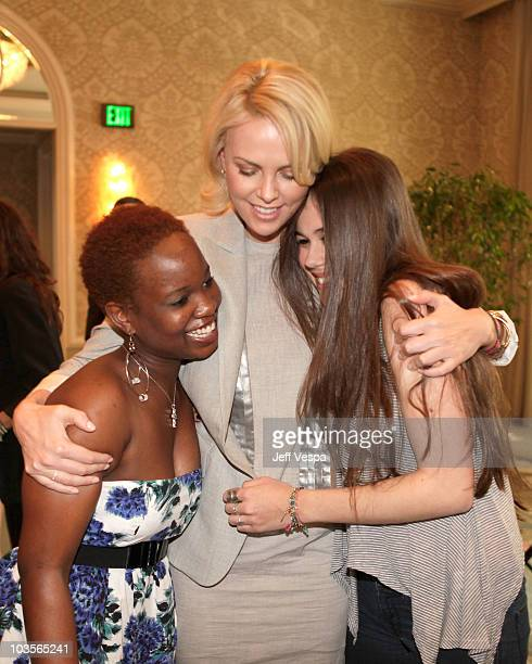 Actors Tanyaradzwa Tawenga Charlize Theron and Chloe Goutal attend VDay's 4th Annual LA Luncheon featuring a reading of Eve Ensler's newest work I Am...