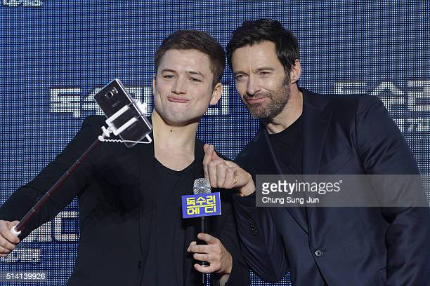 Actors Taron Egerton and Hugh Jackman take a selfie as they attend the premiere for 'Eddie The Eagle' on March 7 2016 in Seoul South Korea Taron...
