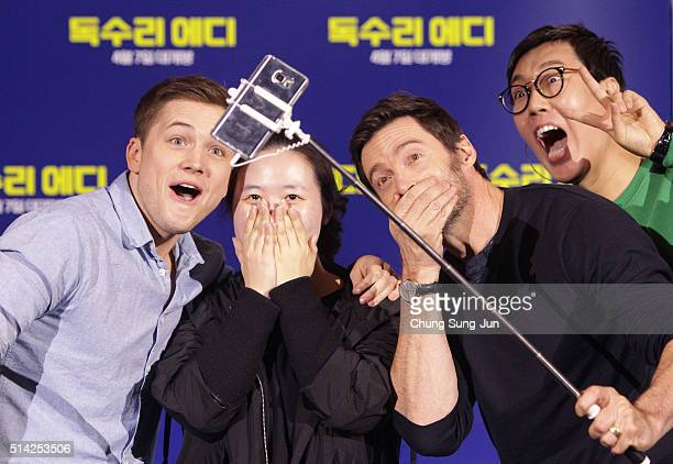 Actors Taron Egerton and Hugh Jackman take a selfie with fan as they attend the 'Eddie The Eagle' Meet The Audience on March 8 2016 in Seoul South...