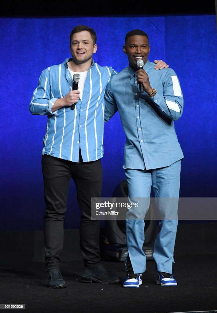Actors Taron Egerton (L) and Jamie Foxx speak onstage during CinemaCon 2018 Lionsgate Invites You to An Exclusive Presentation Highlighting Its 2018 Summer and Beyond at The Colosseum at Caesars Palace during CinemaCon, the official convention of the National Association of Theatre Owners, on April 26, 2018 in Las Vegas, Nevada.
