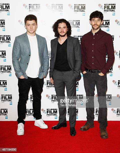Actors Taron Egertonm Kit Harington and Colin Morgan attend the photocall for 'Testament Of Youth' during the 58th BFI London Film Festival at The...