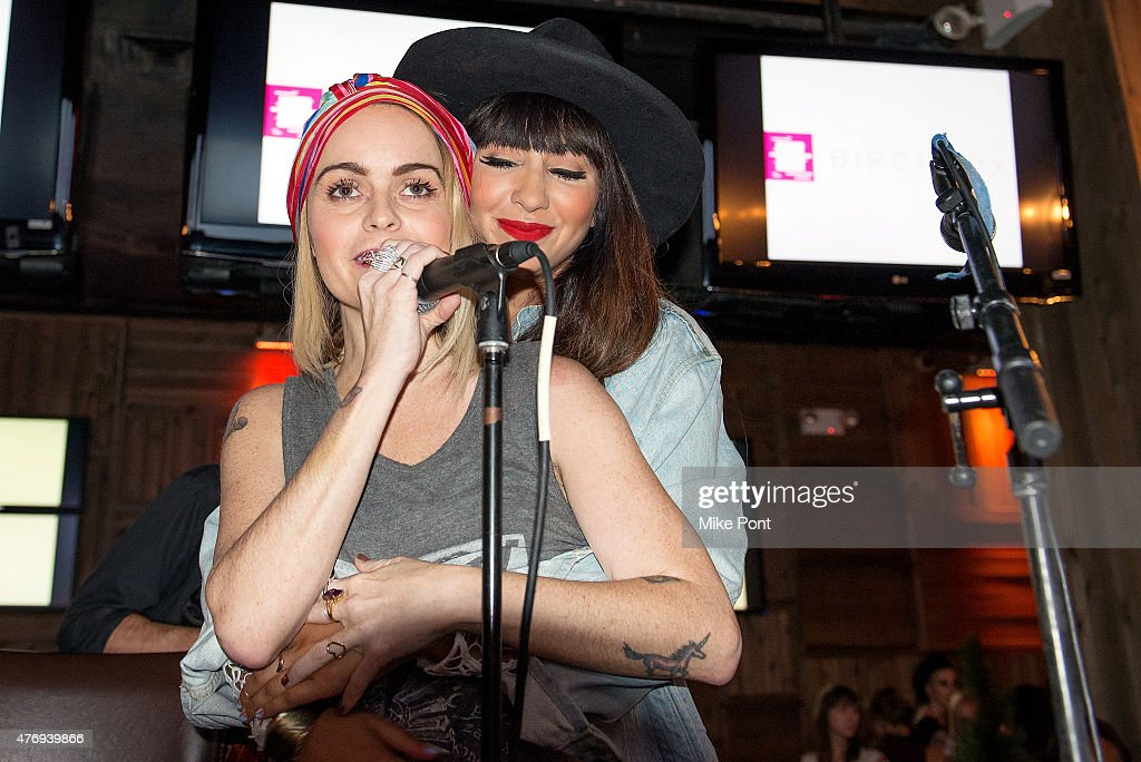 Actors Taryn Manning and Jackie Cruz perform at the 'Orange is the New Black' season 3 premiere party benefiting the Women's Prison Association at The Ainsworth on June 12, 2015 in New York City.